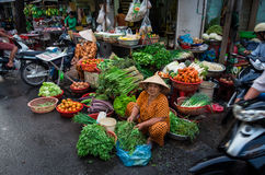 Vegetable seller in Can Tho, Vietnam. A vegetable seller on the footpath in Can Tho in the Mekong Delta region of Vietnam Stock Photography
