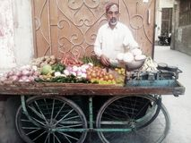 Vegetable seller. In Pakistan many poor people sale vegetables in street through cart. they wake up early in the morning and go to vegetable wholesale market to Stock Image