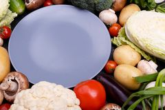 Vegetable set and a blue plate stock photo