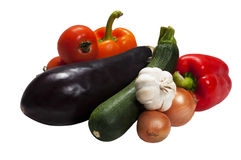 Vegetable set for ratatouille - Isolated. Vegetable set for ratatouille - tomatoes, zucchini, pepper, eggplant, onion and garlic, Isolated in white Stock Photos