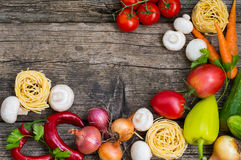Vegetable set on a wooden background. Top view. Close-up. Vegetable set on a wooden background. Top view, produce, vegetarian, paprika Royalty Free Stock Photography