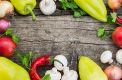 Vegetable set on a wooden background. Top view. Close-up. Vegetable set on a wooden background. Top view, produce, vegetarian, paprika Royalty Free Stock Image