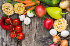 Vegetable set on a wooden background. Top view. Close-up. Vegetable set on a wooden background. Top view, produce, vegetarian, paprika Royalty Free Stock Images