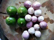 Wood. Shallots and green lemon on wood. Ingrediant for spicy salad Royalty Free Stock Photos