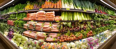Vegetable shelves in the Whole Foods Market stock photography