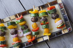 Vegetable shish Kebab. Grilled Vegetable shish Kebab with peppers, mushrooms, tomatoes, zucchini and onions as texture or background. Healthy diet concept Stock Photography
