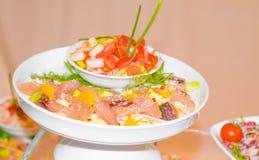 Vegetable with shrimp and tomato near salmon Royalty Free Stock Photo