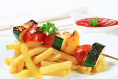 Vegetable skewer and French fries Stock Photography