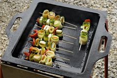 Vegetable skewers. With cheese on barbeque Royalty Free Stock Images