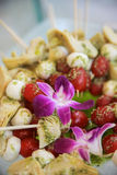 Vegetable skewers and flowers Stock Images