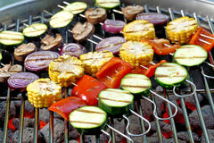 Vegetable skewers. Skewers with mixed vegetables on hot barbecue charcoal briquettes Stock Photos