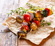 Vegetable skewers. Vegetarian grilled skewers with mushrooms,tomatoes,onions, peppers, zucchini and eggplant. Delicious and healthy dish Royalty Free Stock Photo
