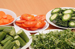 Vegetable slices. Fresh vegetable slices arranged in plates Stock Photos