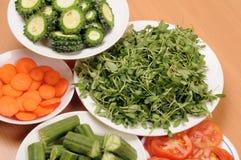 Vegetable slices. Fresh vegetable slices arranged in plates Stock Photo
