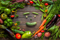 Vegetable smiling face. Fresh organic Vegetables on Wooden table. Healthy Vegetarian food, View from above stock image