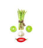 Vegetable smiling face from red chili pepper , garlic , asparagus and lime on white background Stock Images