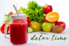 Vegetable smoothie in small bottles, dark wood background, selective focus. Jar of a glass with smoothies from fruits and vegetables. detox time inscription Stock Image