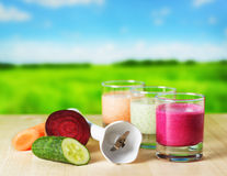 Vegetable smoothie. On wooden table on the rural background Royalty Free Stock Image