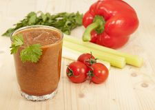 Vegetable Smoothies of tomato. Pepper and celery and parsley Stock Photos