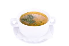Vegetable soup. In a white cup on a white background Royalty Free Stock Images