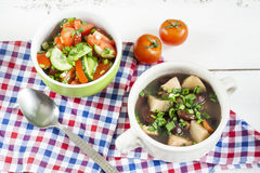 Vegetable soup with beans and chicken, fresh herbs in a clay pot Royalty Free Stock Images