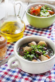 Vegetable soup with beans and chicken, fresh herbs in a clay pot Stock Photography
