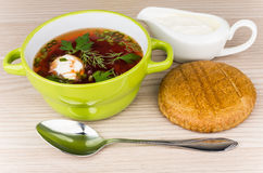 Vegetable soup with beets, bread and sour cream Royalty Free Stock Images