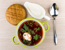 Vegetable soup with beets, bread and sour cream Royalty Free Stock Photo