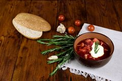 Vegetable soup with beets, rustic style, selective focus.  Royalty Free Stock Photo