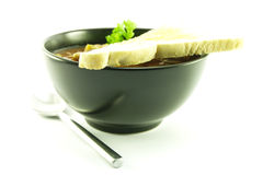 Vegetable Soup in a Black Bowl Stock Photo