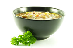 Vegetable Soup in a Black Bowl Stock Images