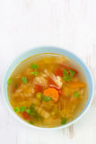 Vegetable soup in blue bowl Stock Image