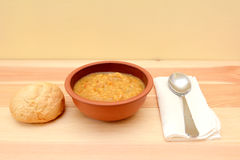 Vegetable soup in a bowl with crusty bread roll Stock Image