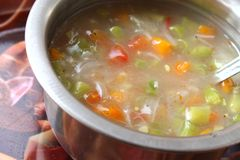 Vegetable soup in a bowl made of beans, carrots and tomato Royalty Free Stock Photos