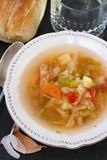 Vegetable soup with bread. And water stock photo