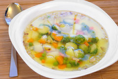 Vegetable soup with brussels and pea Royalty Free Stock Photo
