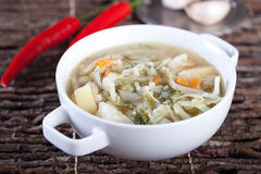 Vegetable soup with cabbage, potatoes and carrot Stock Photo