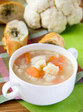 Vegetable soup with cauliflower and carrots. Vegetable soup with cauliflower, garlic and carrots in white cup Stock Images