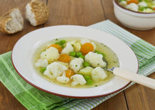 Vegetable soup with cauliflower and green peas Stock Images