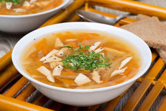 Vegetable soup with chicken and greens, close-up Royalty Free Stock Image