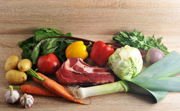 Vegetable soup collection meat - potatoes, tomatoes, carrots, ga. Rlic, leeks, beets, pepper, parsley and beef on wooden background Royalty Free Stock Image
