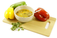 Vegetable soup and colorful peppers Stock Photography