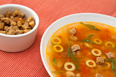 Vegetable soup and crackers. Vegetable lentil soup with olives and crackers Royalty Free Stock Images