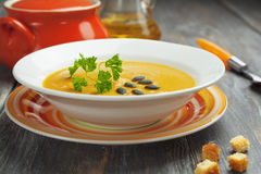 Vegetable soup. Decorated parsley and pumpkin seeds Stock Image