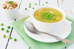 Vegetable soup with green peas Royalty Free Stock Image