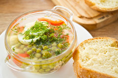 Vegetable soup with green peas Royalty Free Stock Photos