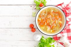 Vegetable soup. Healthy food, vegetarian dish. Vegetable soup with cabbage, potato, tomato, carrot, celery, pepper and green peas. Vegan diet menu. Top view stock photos