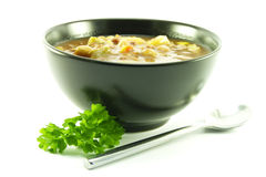 Vegetable Soup In A Black Bowl Stock Image