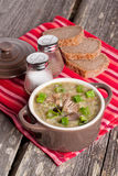 Vegetable soup with lentils in a pot, horizontal. Close up Stock Image