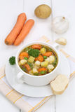 Vegetable soup meal with vegetables and baguette Stock Image